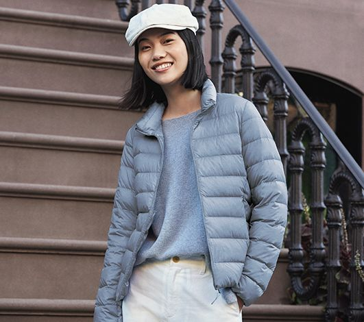 girl standing on steps wearing a down jacket from Uniqlo